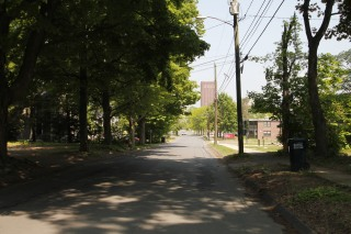 A residential street lies adjacent to the UMass campus.