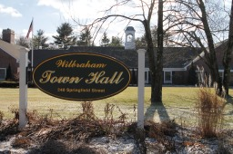 Wilbraham selectmen raised the real estate tax rate, but the average assessed valuation dipped slightly.
